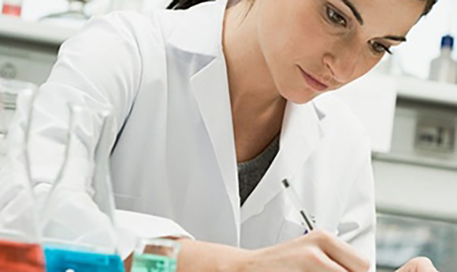 Picture of lab employee writting