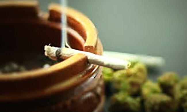 burning marijuana cigarette on ashtray
