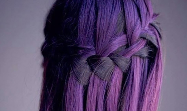 Woman with purple hair in a braid
