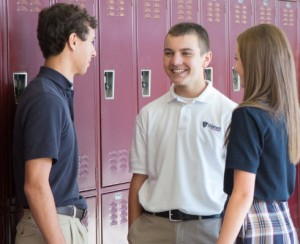 students talking by their lockers