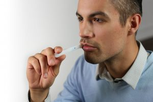 Man taking an Oral-Eze drug test