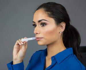 Woman taking an oral fluid drug test