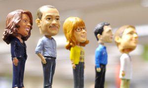 Five bobble heads of Quest Diagnostics professionals