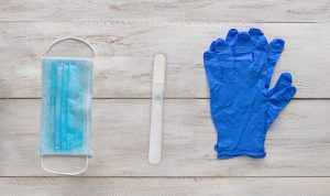 Gloves, face mask and Oral-Eze oral fluid drug test