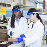 Two women working in a Quest drug testing lab