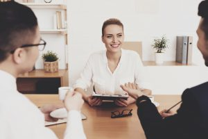 HR director woman is working in office. Woman is sitting at job interview.